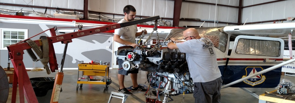 Matt and Harald mounting an engine from oh on a 2004 Cessna 182T cap plane